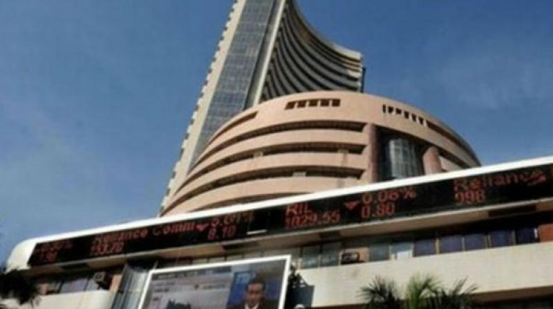 Sensex surges to record high in late morning trade