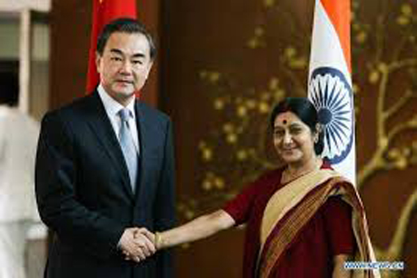 Sushma meets Wang, upbeat on Sino-Indian ties