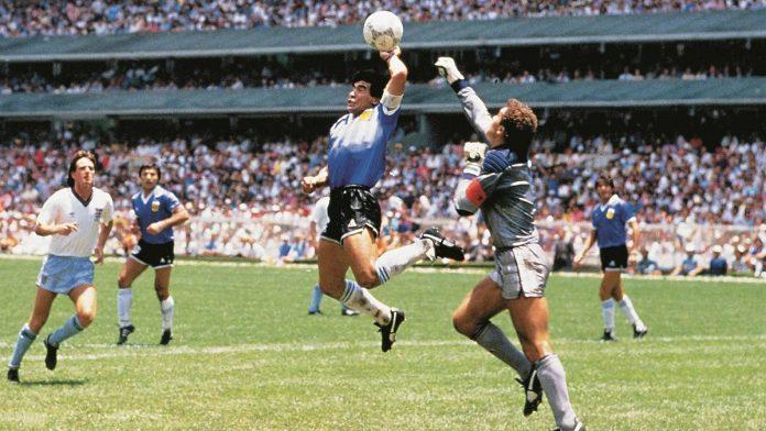 Maradona goes off to shake the Hand of God